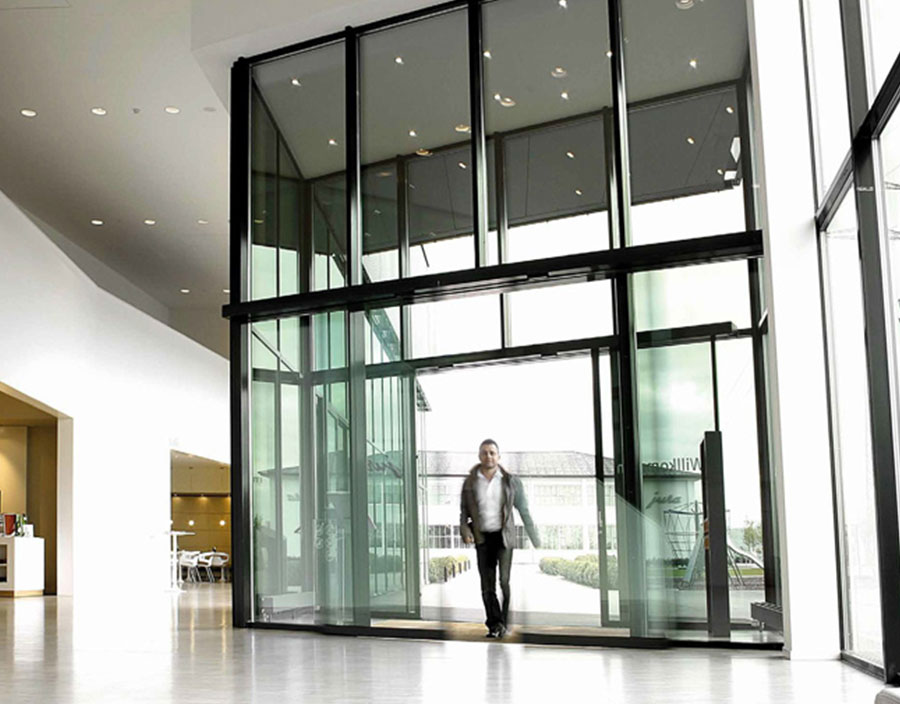 Beautiful entrance with man walking through automatic doors