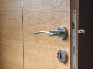 Office door showing a handle and lock