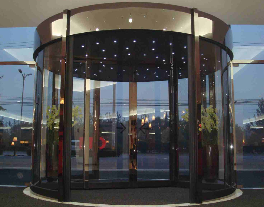 Revolving Door with Bronze Trim